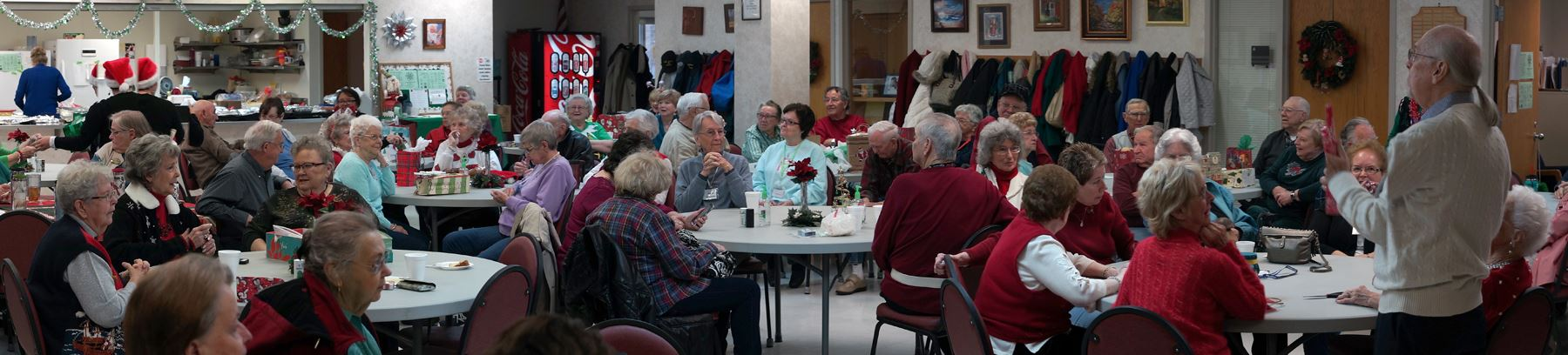 Seniors Sitting Around Tables for the Holidays